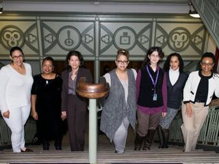 Faculty advisor Vanessa K. Valdés [left] with CCNY's CUNY Mellon Faculty Fellows Trevar Riley-Reid, Norma Fuentes-Mayorga, Nilda Sanchez-Rodriguez, Andrea Felber Seligman, Laurie Woodard and Tashuna Albritton.