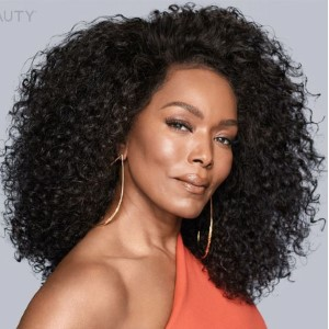 Angela Basset is looking into the camera from the side