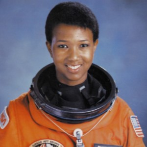 Mae Jemison M.D. looking into the camera in a space suit