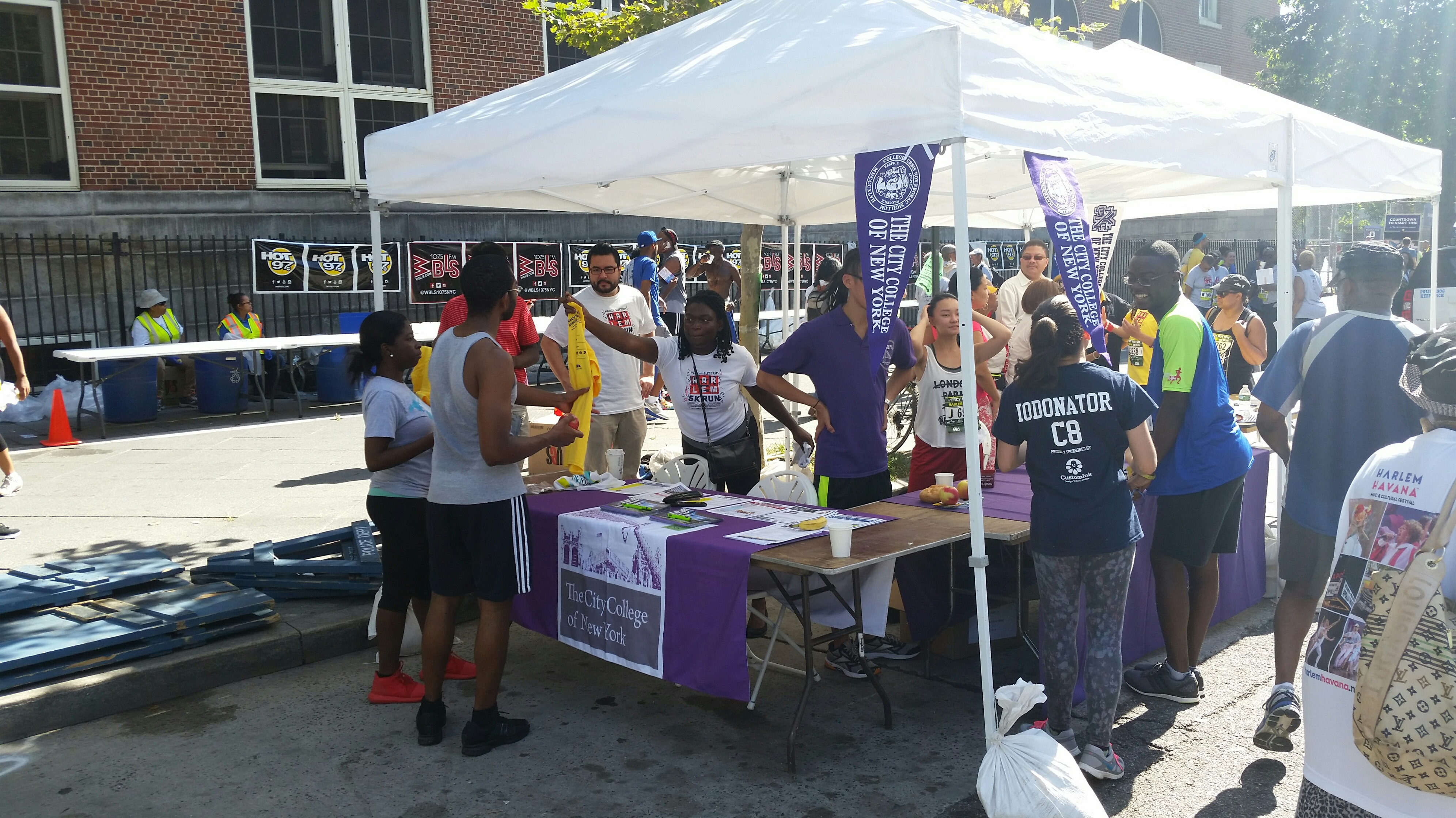CCNY participants gather around the information booth.