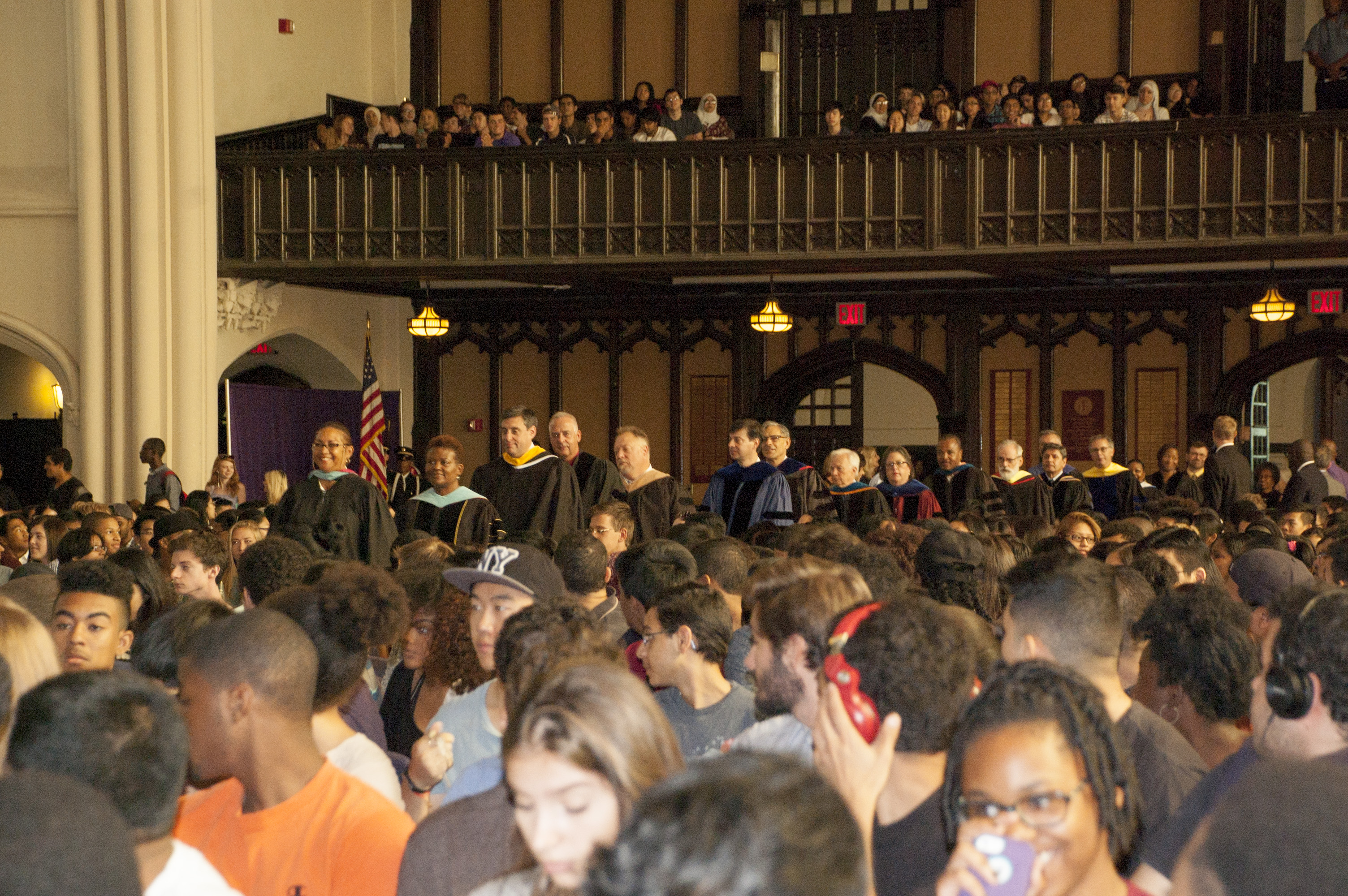 The freshman class sits and watches faculty, staff and administrators as they walk down the aisle of the Great Hall for Freshman Convocation.