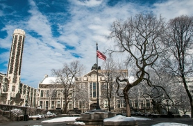 Photo of the Quad in Winter with Snow on the Ground and an American Flag Flying