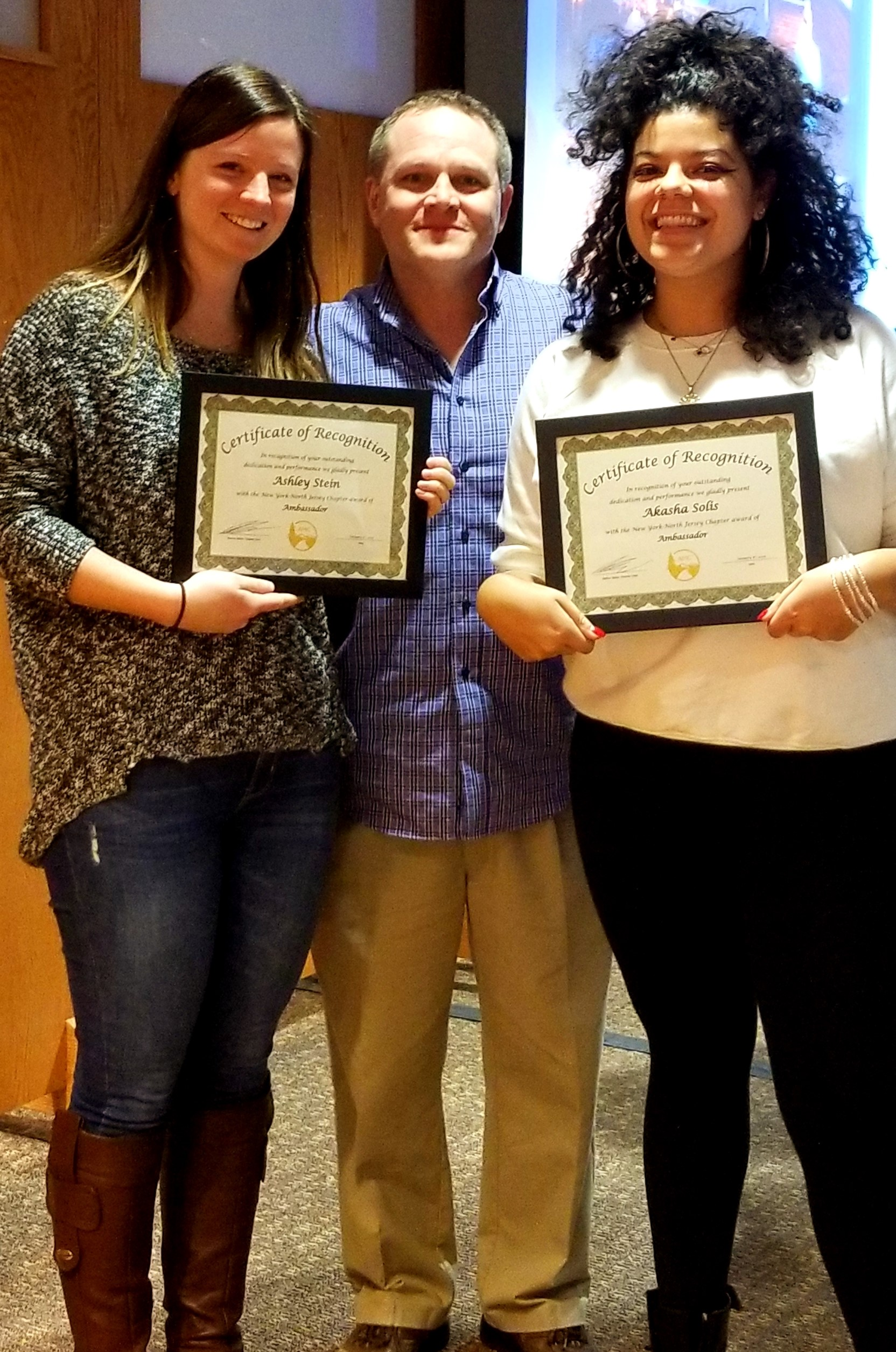 CCNY alumni Ashley Stein (left) and Akasha Solis (right) celebrate their recognition with Nathan Baker, AMC NY/No-J Chapter Chair