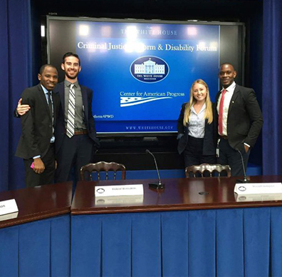Abubakar Usman (far left) and Asshur Cunningham (far right) helped coordinate a White House briefing on criminal justice and disability reform.