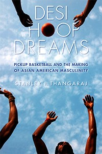 """A blue sky with patches of clouds and muscular arms reach out for a basketball. White letters say """"Desi Hoop Dreams"""" while blue letters say """"Pickup Basketball and the Making of Asian American Masculinity."""" By Stanley I. Thangaraj"""