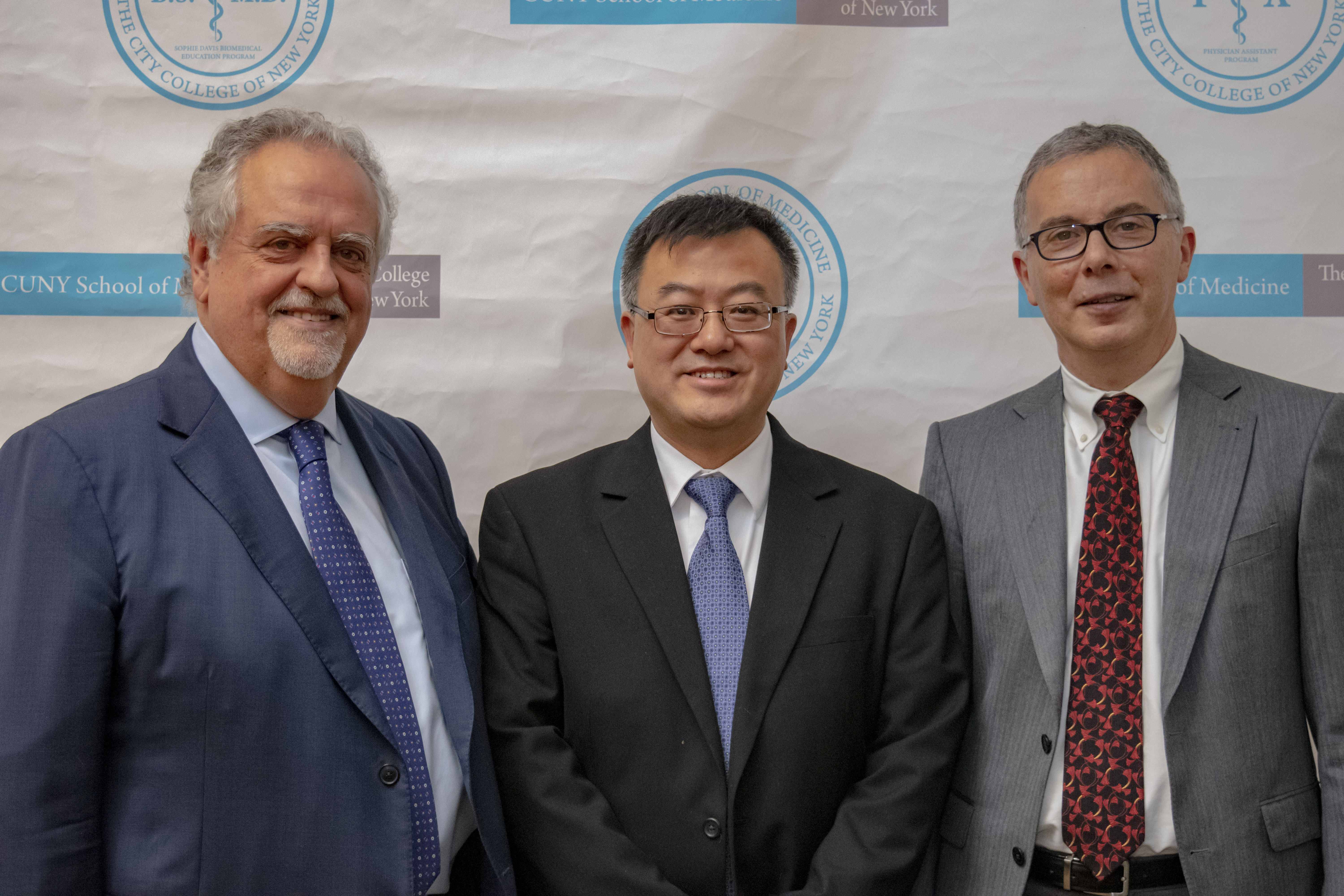 Image of Dean Maurizio Trevisan, Dr. Alan Yao, Provost Tony Liss