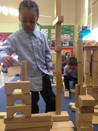 Photo of a child playing with wooden blocks