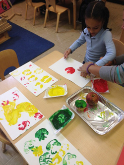 Children making handprints