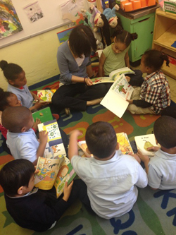 Student teacher and children reading stories