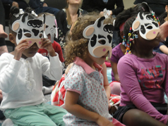 Children wearing cartoon masks