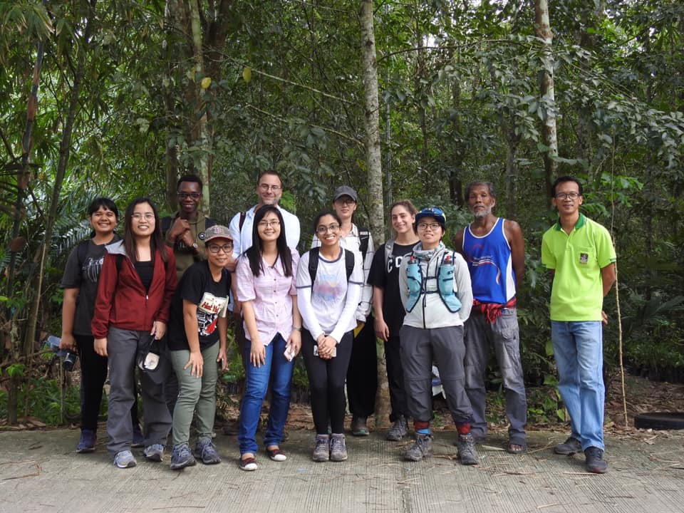 Photo of David Lohman and students in Thailand