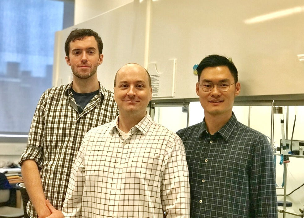 Ph.D. candidates Benjamin Murray, left, and Shibin Zhao, right, flank CCNY chemistry professor Mark Biscoe.