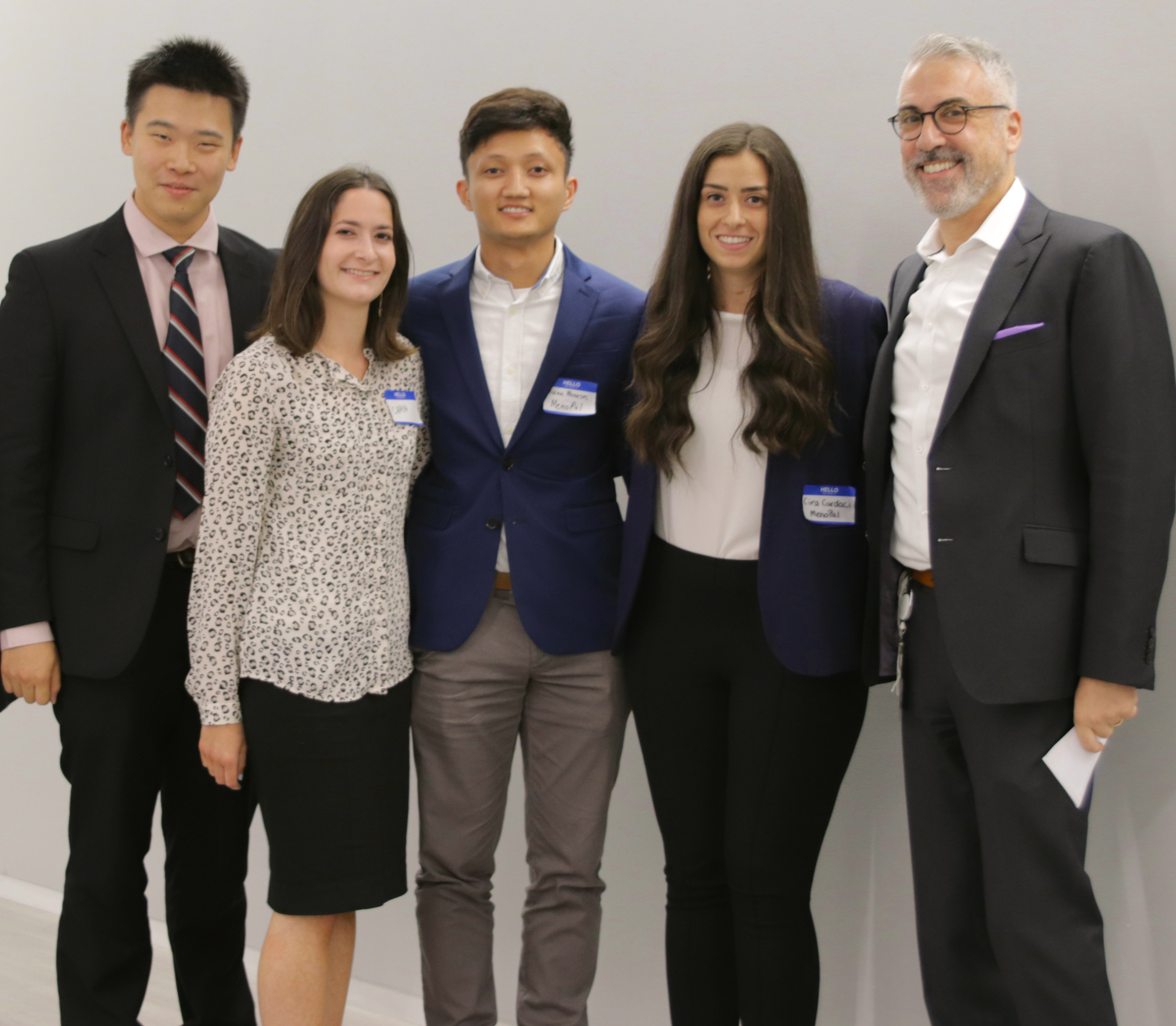 Team MenoPal (from left) Bo Guan, Chaya Edelman, Mican Meneses and Cira Cardaci with fellow CCNY alum and Nestle SHIELD senior medical director and head of medical innovation Dr. Warren Winkelman.