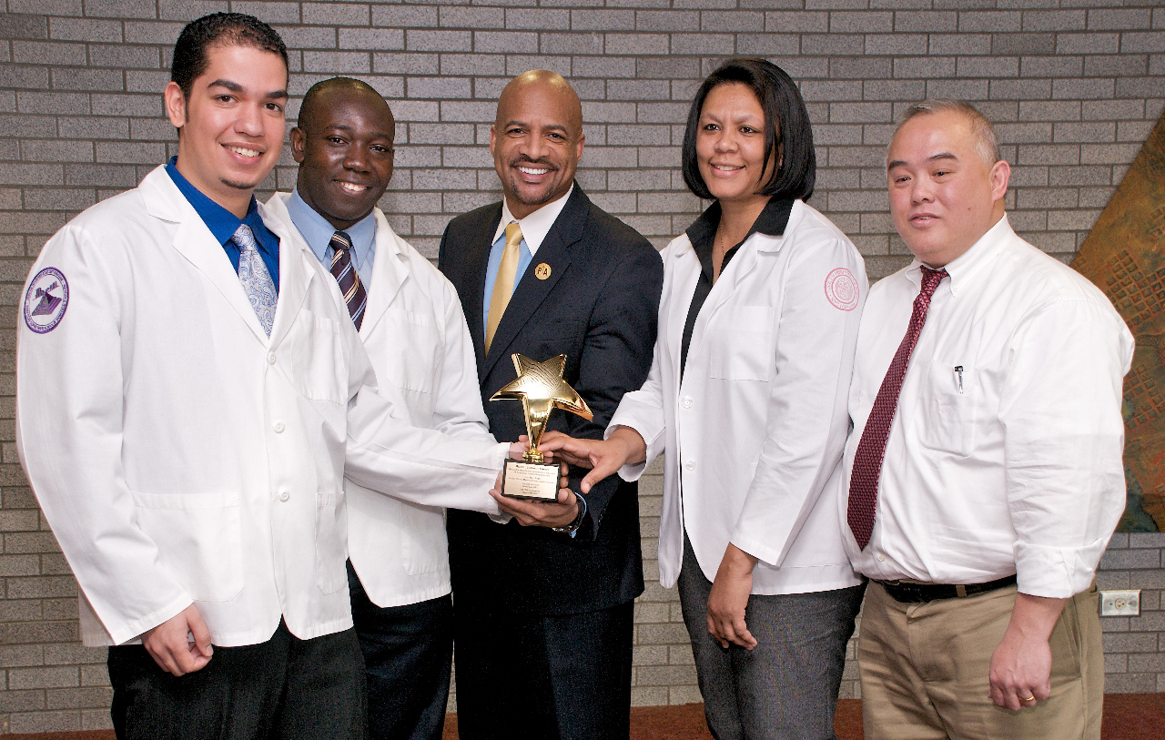 The 2009 New York State Physician Assistants Association (NYSPAA)  Medical Jeopardy challenge was won by a team from The Sophie Davis School of Biomedical Education.  At the trophy presentation were (left to right): senior Miguel Santiago; senior Ifeanyi Nwobi; Adrian Llewellyn, president-elect of NYSPAA; junior Patricia Nelson, and team Coach David Lau.