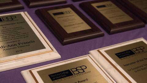 Awards laid out on the table. the table is a purple color