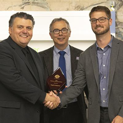Professor Angelo Lampousis (left) with Tony M. Liss, provost and senior vice president for Academic Affairs, and Travis Murdock, ASTM International.