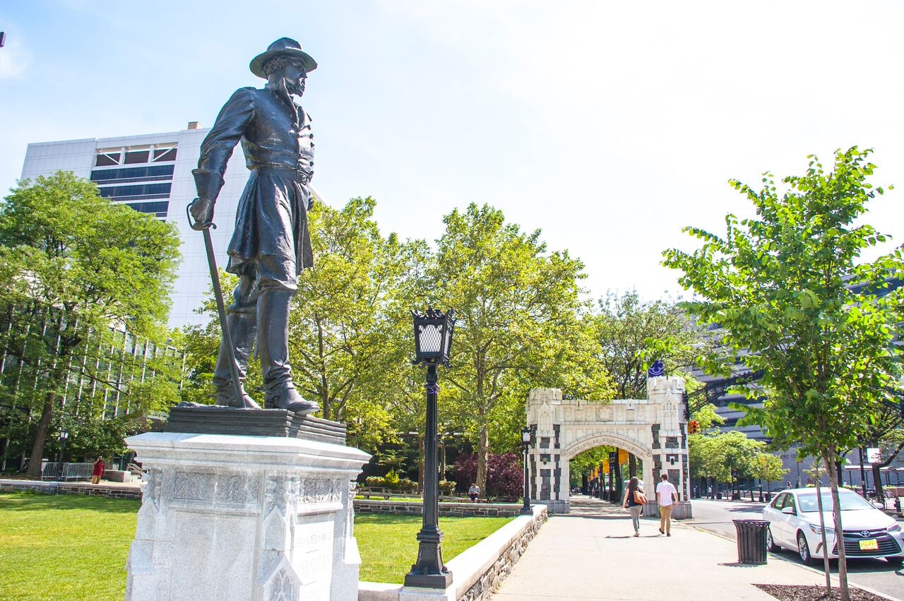 Photo of campus with statue of General Webb