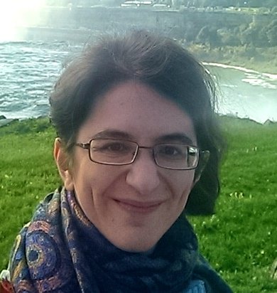 Head shot of Professor Felber-Seligman standing by Niagara Falls in fall 2018
